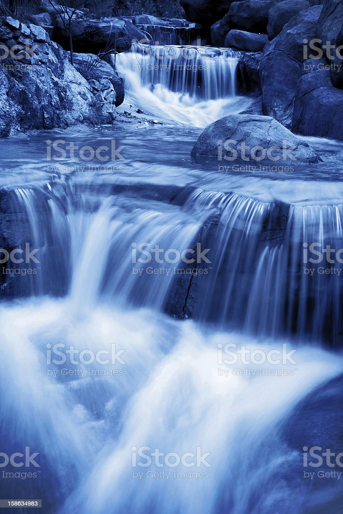 Waterfall in rain forest royalty-free stock photo