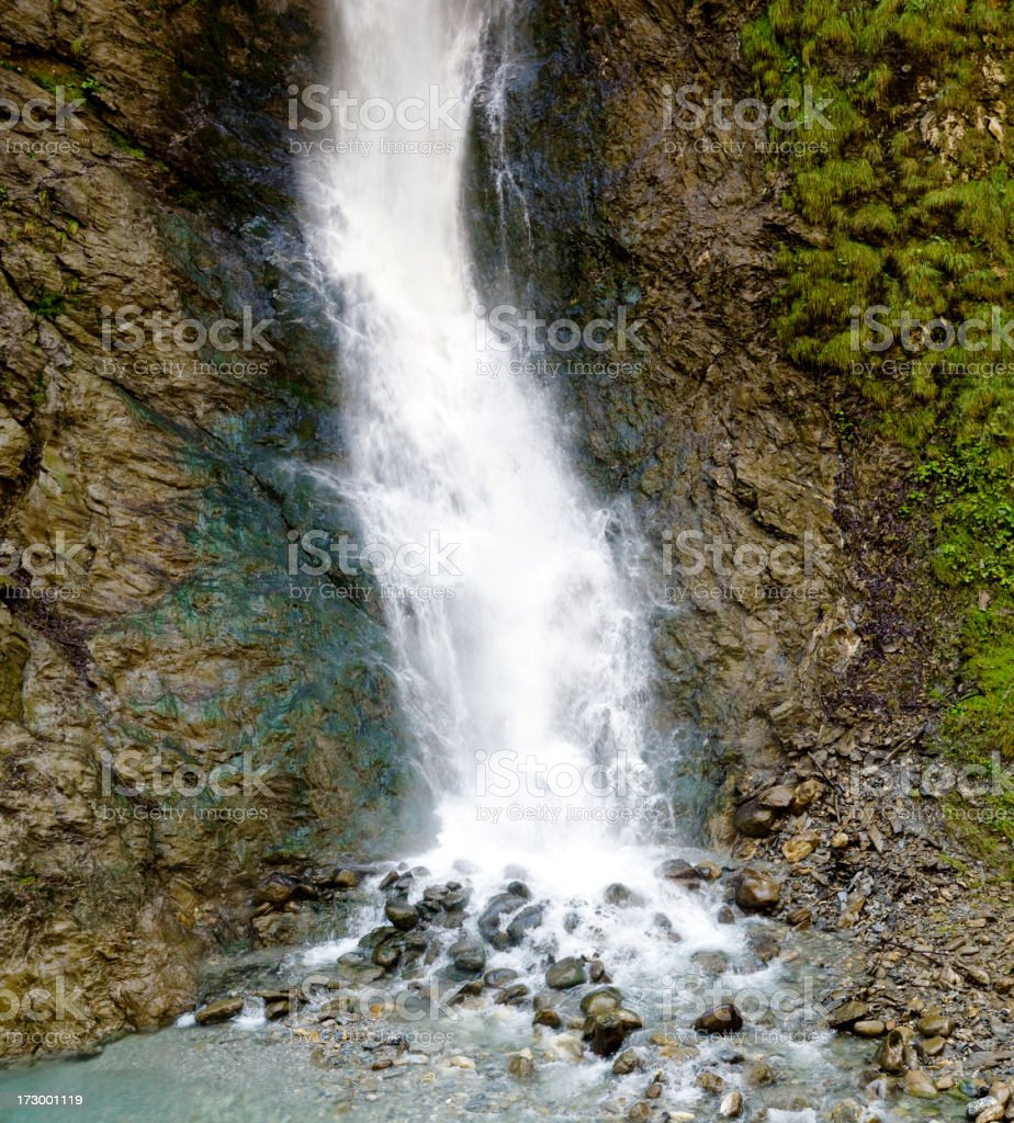 Waterfall in the Alps stock photo