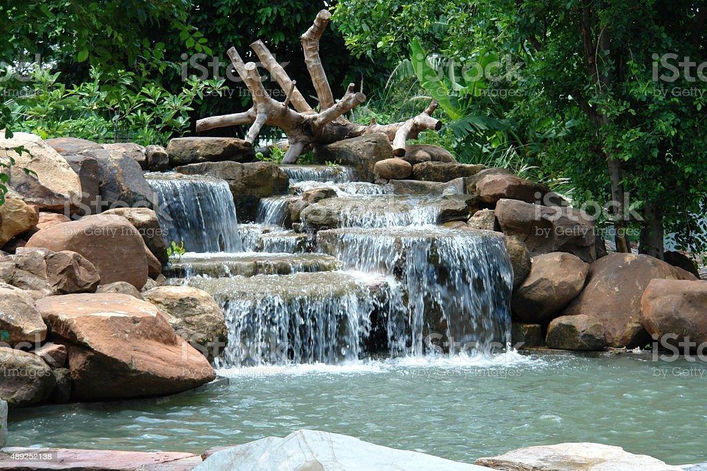 Waterfall in the garden area stock photo