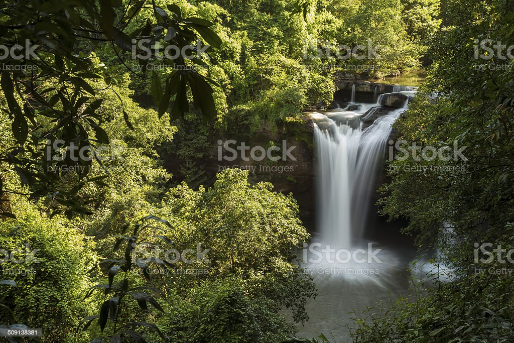 Waterfall in the green forest stock photo