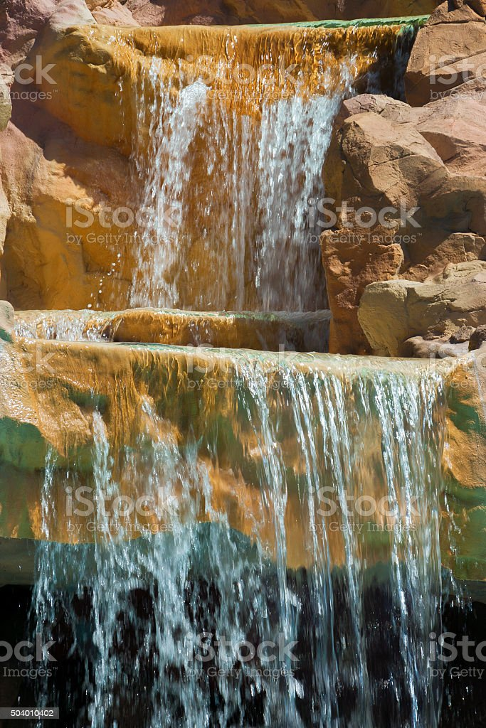 Waterfall in the mountains stock photo