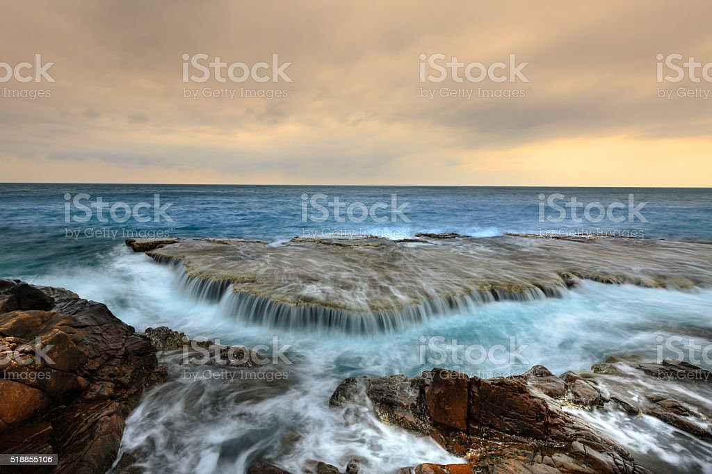 waterfall in the ocean stock photo