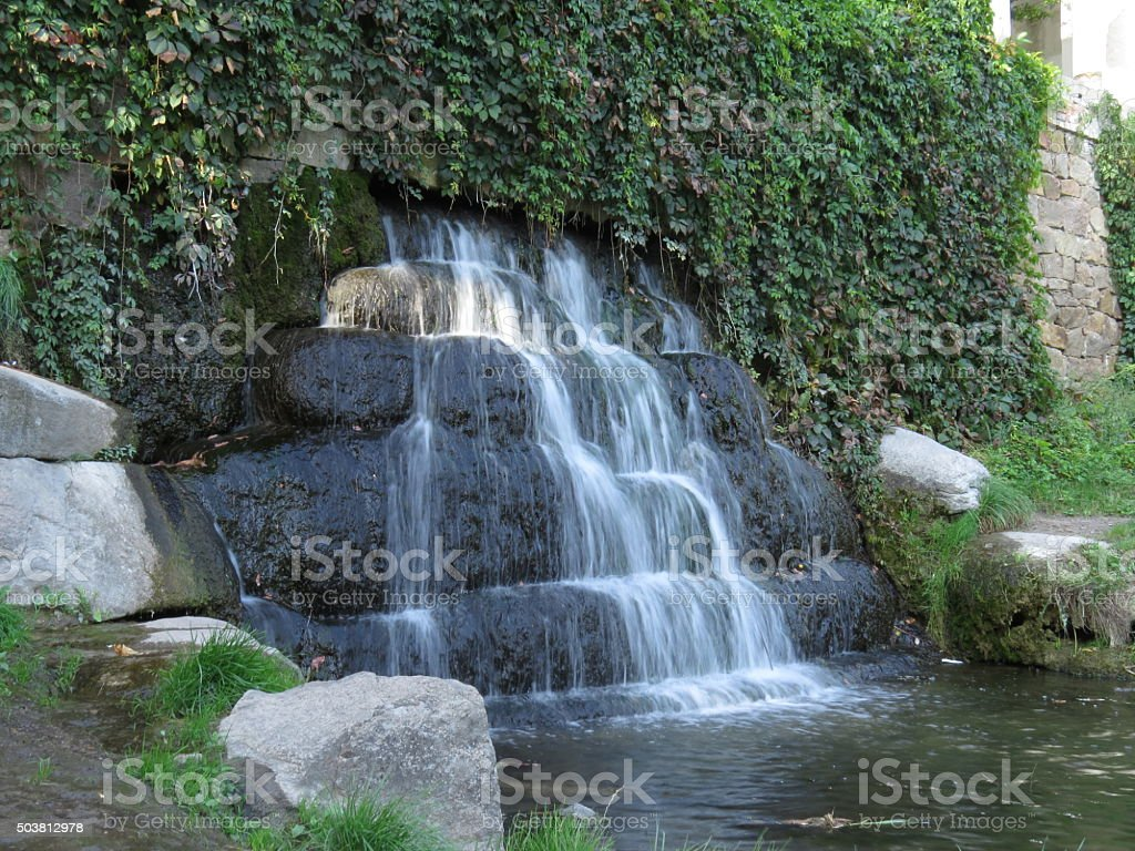 Waterfall in the park stock photo