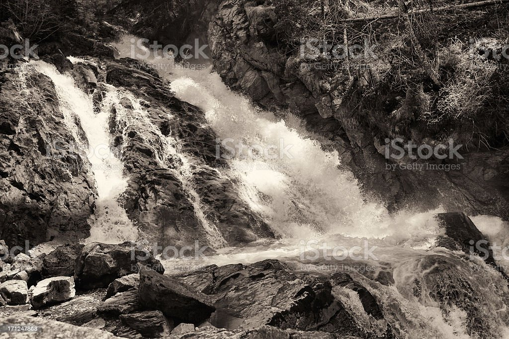 Waterfall in the Swiss Alps, Simmentalfaelle, Spring, Monochroma stock photo