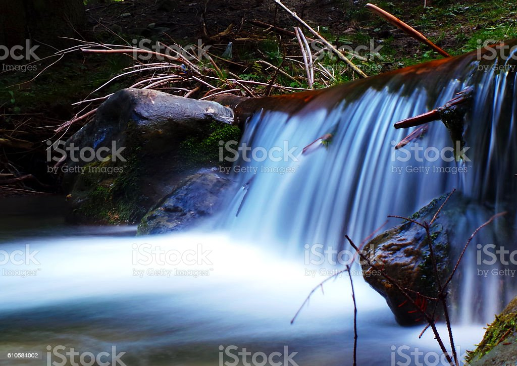 Waterfall in the wild forest stock photo