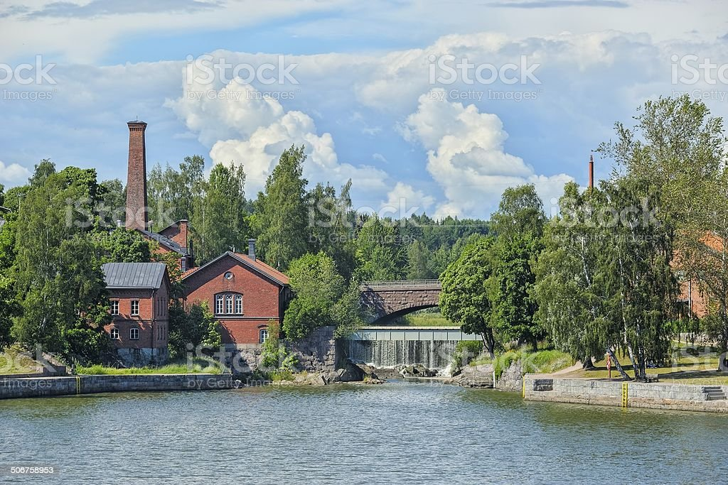 Waterfall in Vanhankaupunginkoski and old power station, Helsink stock photo