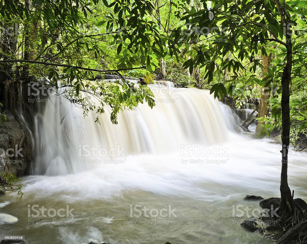 Waterfall in yellow stream royalty-free stock photo