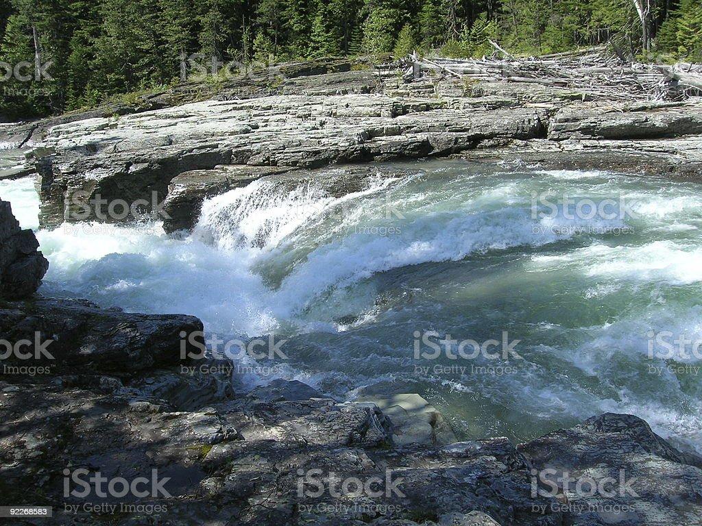 Waterfall into Lake McDonald royalty-free stock photo