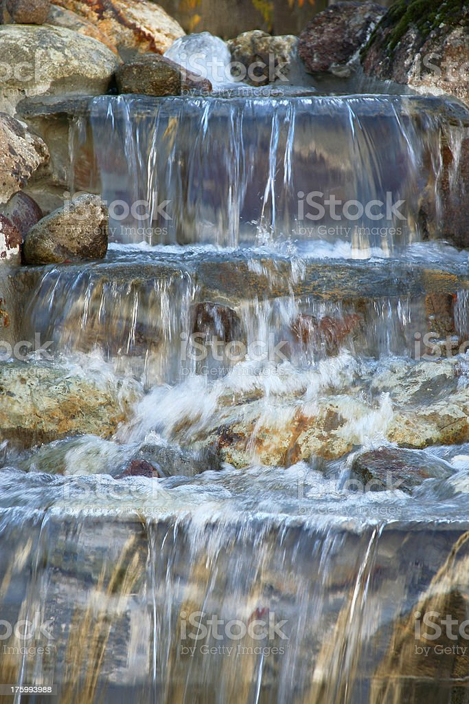 Waterfall into the swimming pool royalty-free stock photo