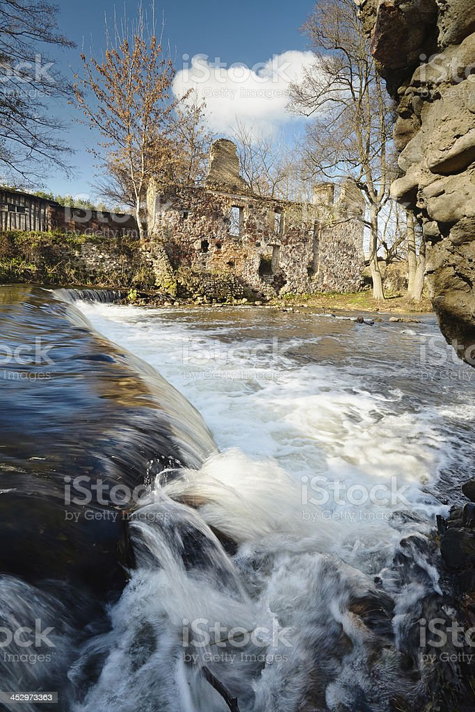 Waterfall  near ruins of old mill royalty-free stock photo