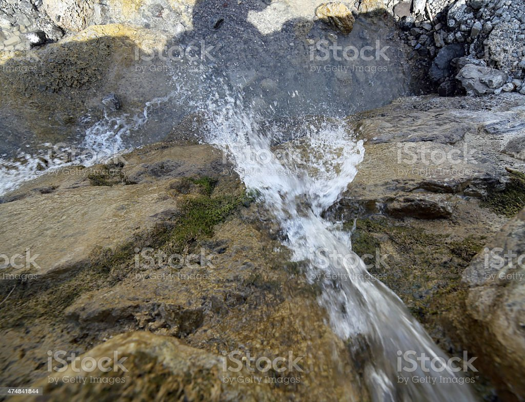 waterfall of fresh water in the mountain torrent stock photo
