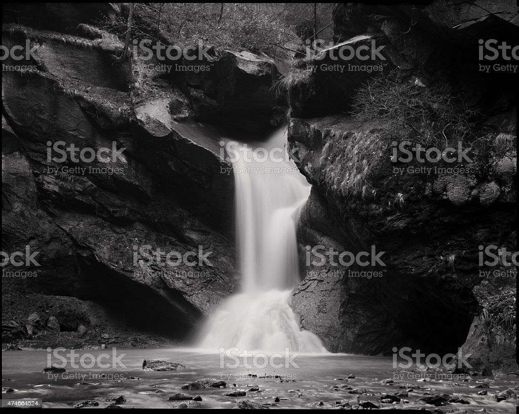 Waterfall on a black stones stock photo