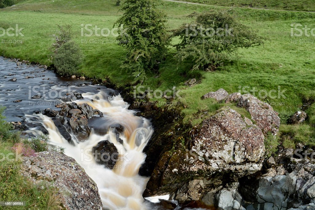 Waterfall on a Scottish river in Dumfries and Galloway stock photo