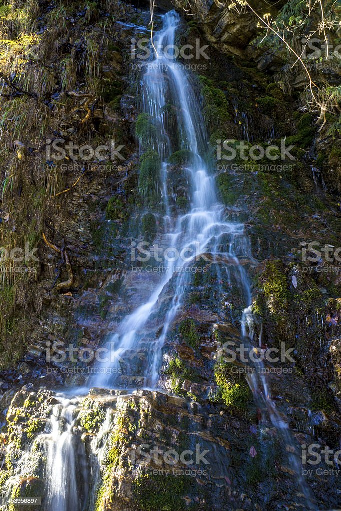 Waterfall on mountain stream stock photo