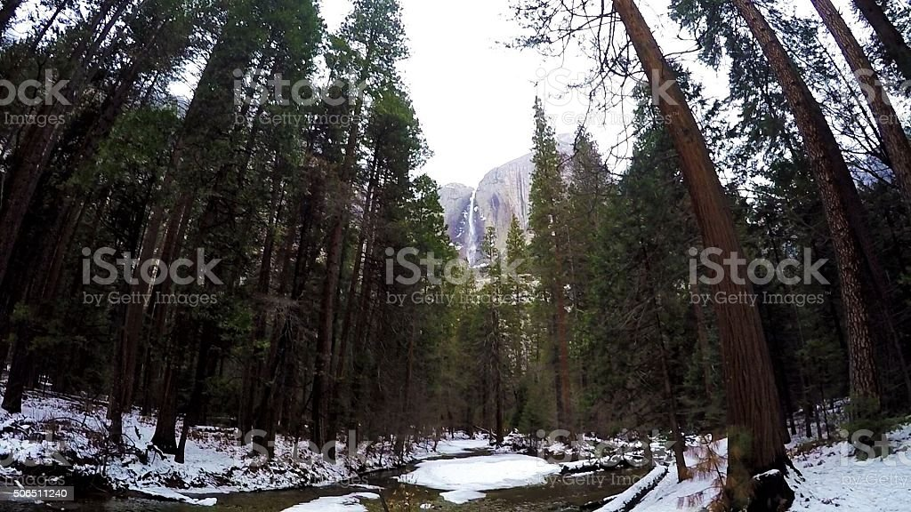 Waterfall on snow stock photo