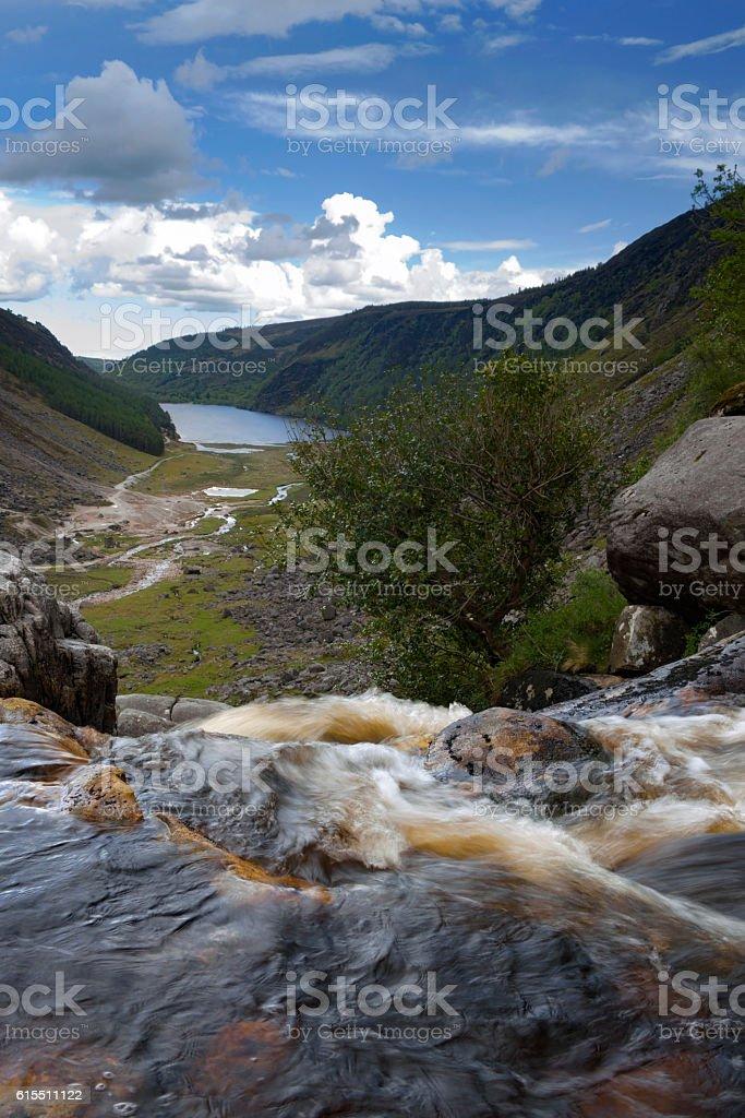 Waterfall overlooking glendalough upper lake stock photo