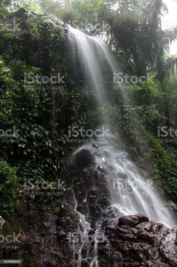 waterfall rainbow dew, curug ibun pelangi stock photo