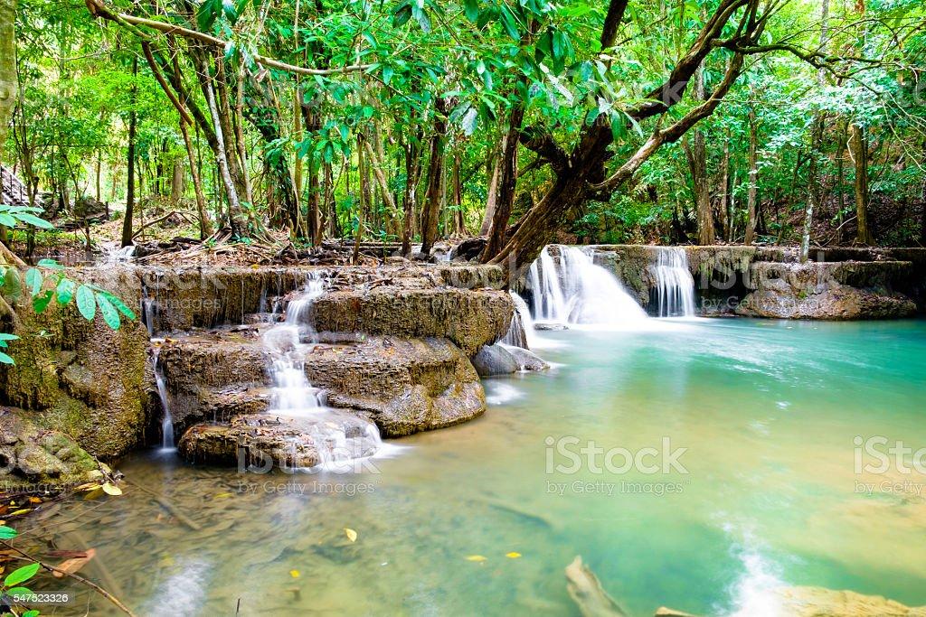 Waterfall scenic natural in rainforest at huai mae khamin stock photo