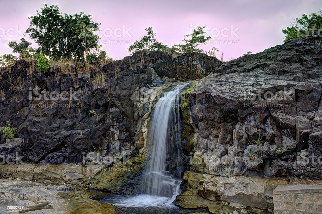 Waterfall, Stones and the Sky stock photo