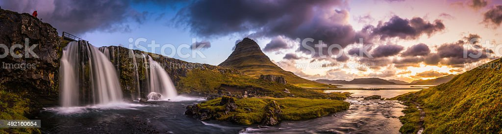 Waterfall sunrise idyllic mountain stream through panoramic peaks Kirkjufell Iceland stock photo