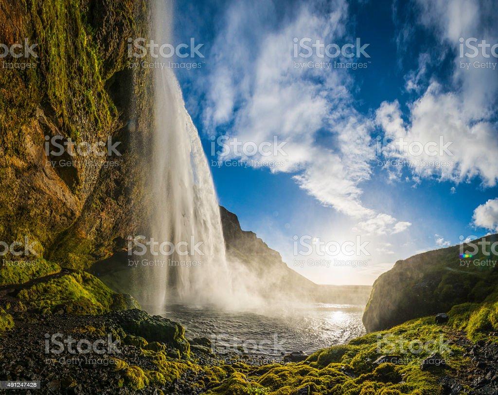 Waterfall sunset idyllic cascade tumbling into mountain lake Seljalandsfoss Iceland stock photo