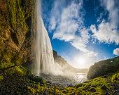 Waterfall sunset idyllic cascade tumbling into mountain lake Seljalandsfoss Iceland