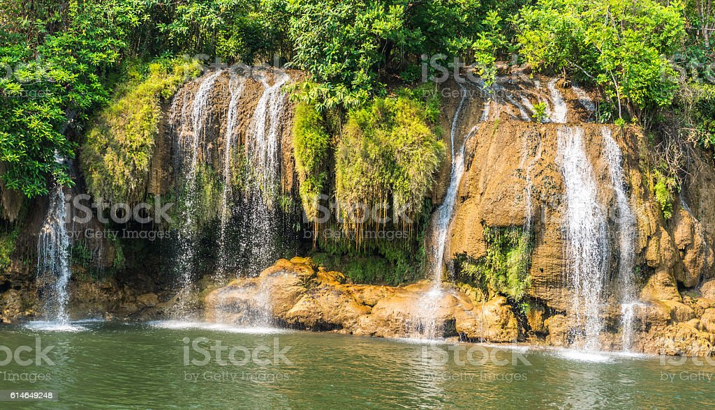 Waterfall view at the river Kwai, Kanchanaburi, Thailand. stock photo