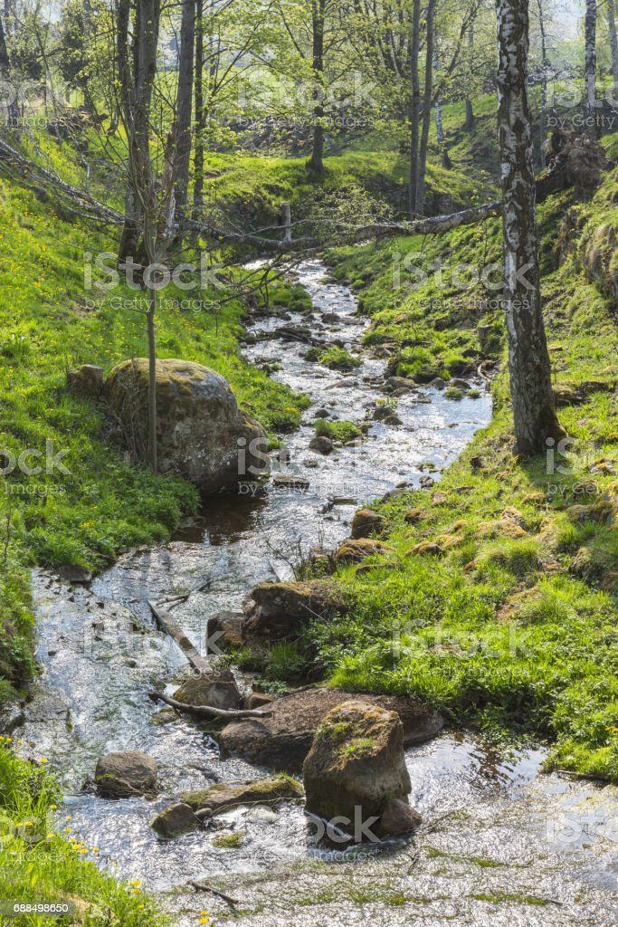Waterfall with a creek stock photo