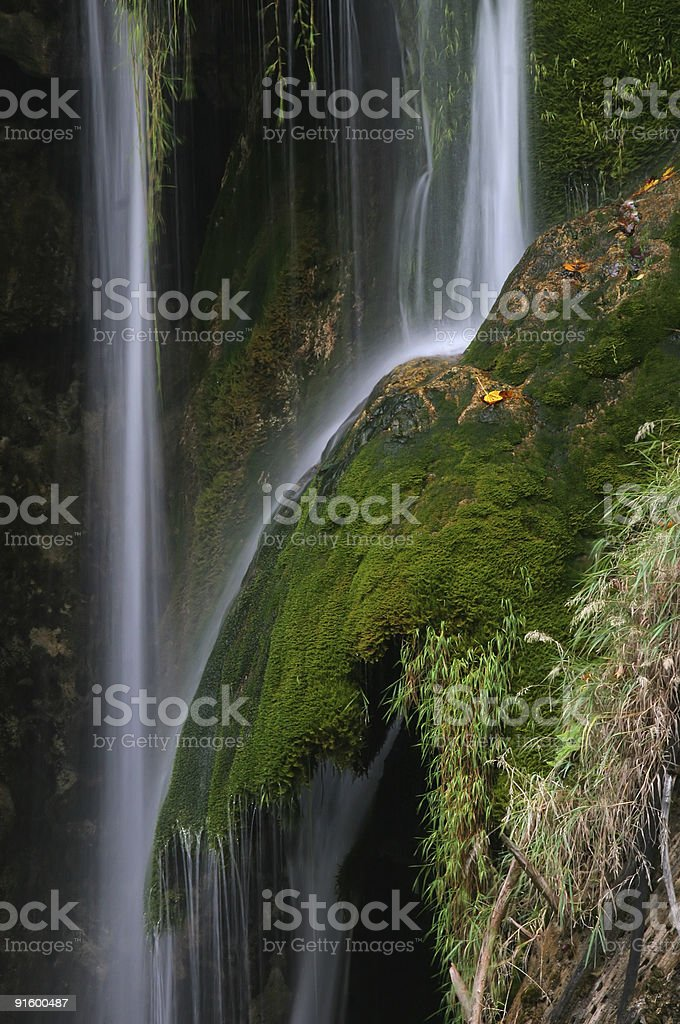 Waterfall with beautiful green colors stock photo