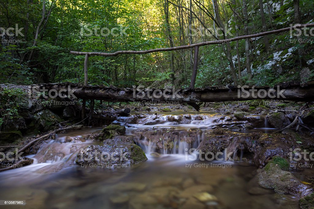 Waterfall with bridge in the Natural reservation Cheile Nerei, Romania stock photo