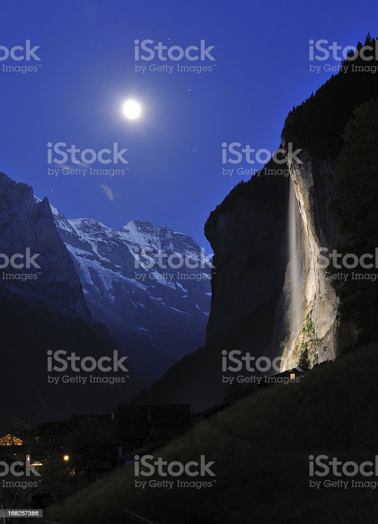Waterfall with Moonlight in Switzerland royalty-free stock photo