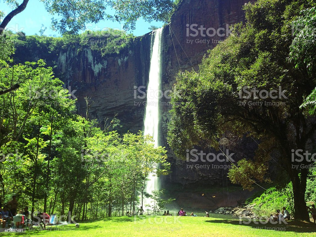 Waterfall with people. stock photo