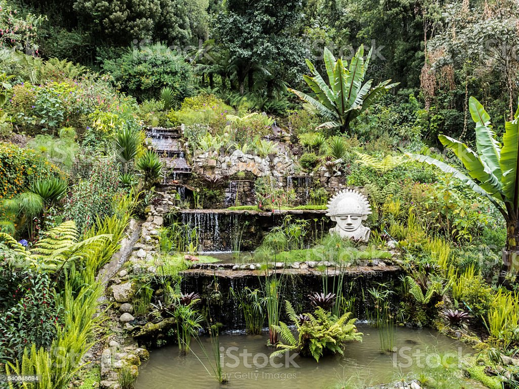 Waterfall with small statue stock photo