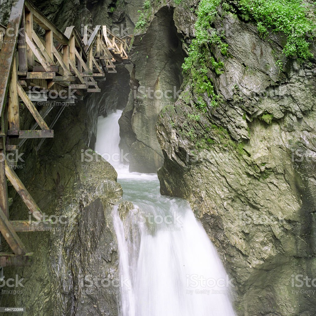 Waterfall with wooden walkway royalty-free stock photo