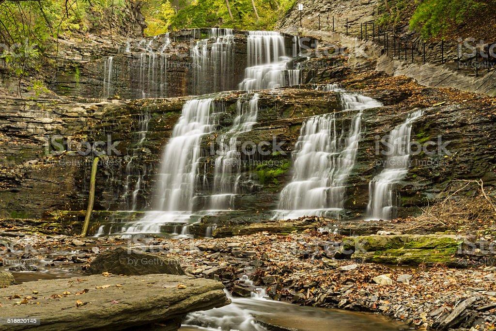Waterfalls and Cornell Walkway in Cascadilla Gorge stock photo