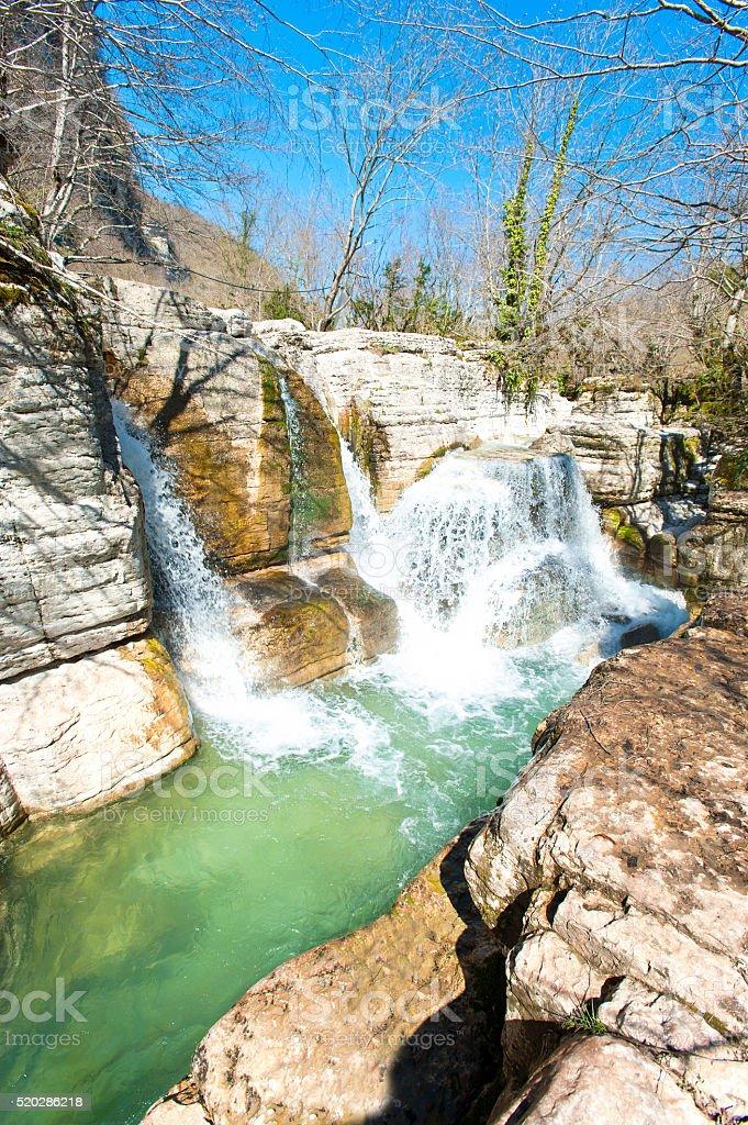 Waterfalls in woodland of Okatse canyon, Georgia. stock photo