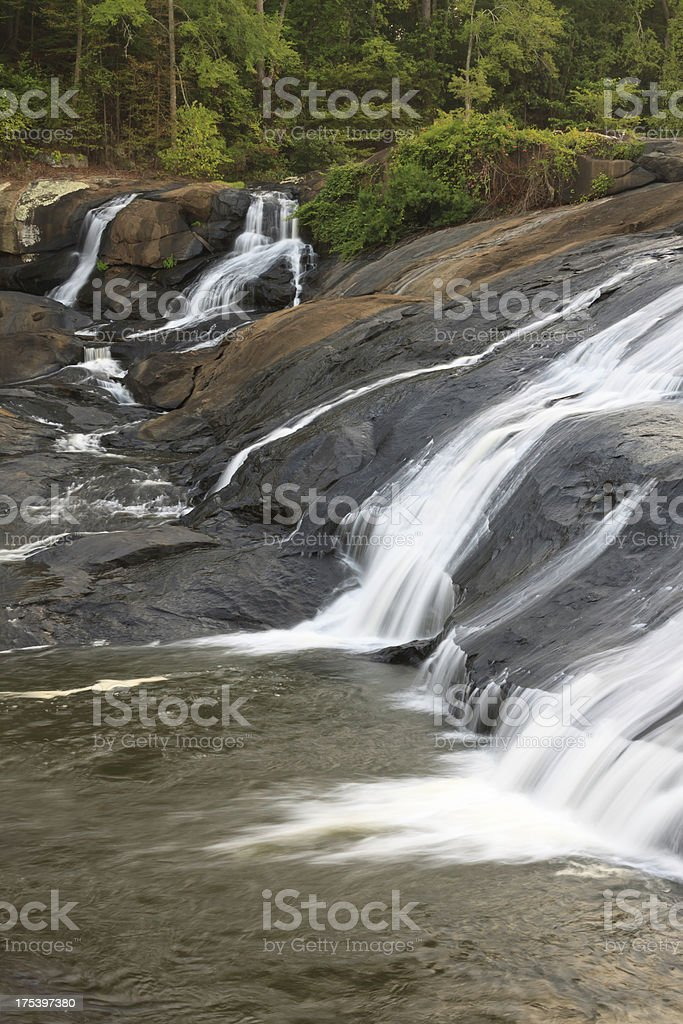 Waterfalls Over Large Rock Formation stock photo