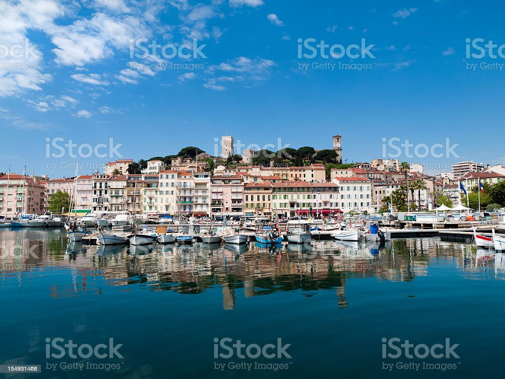 Waterfront and boat harbor in Cannes, France stock photo