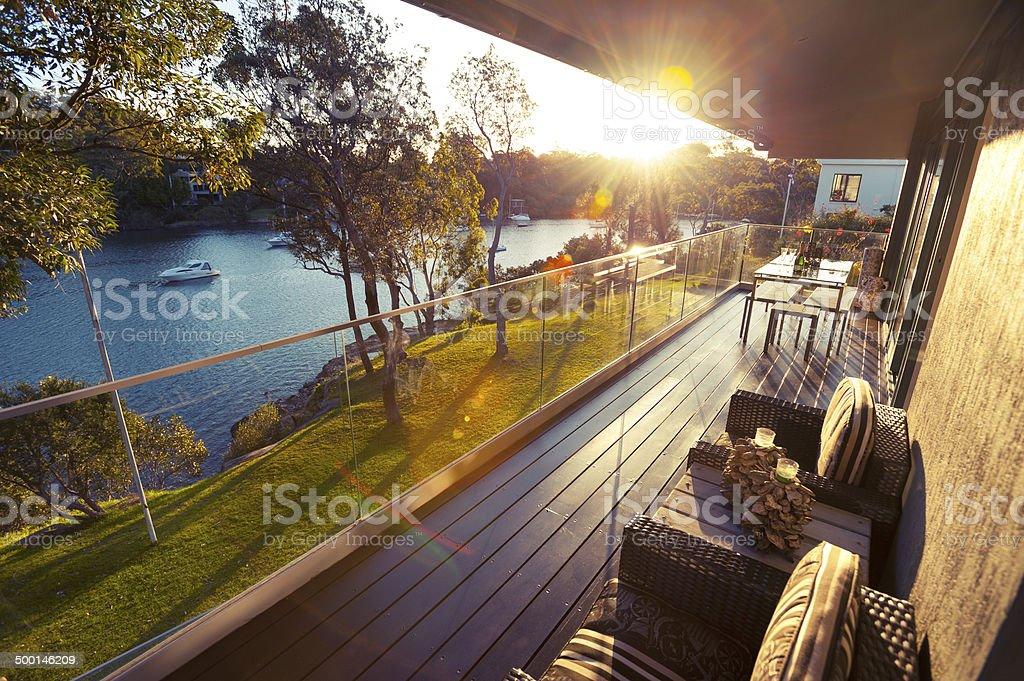 Waterfront house balcony stock photo