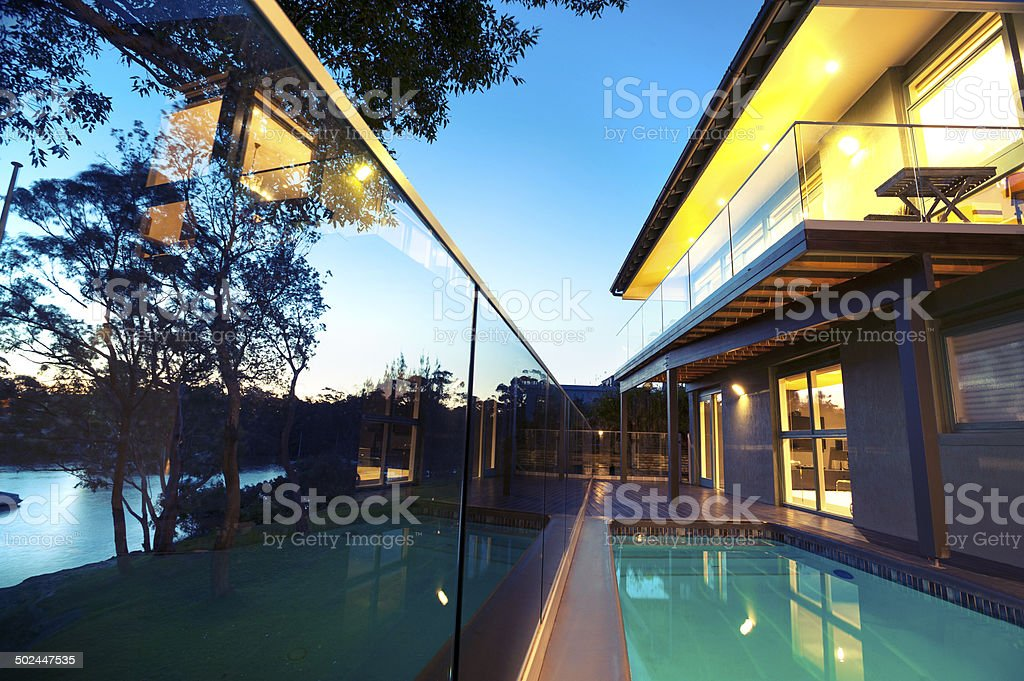 Waterfront house with swimming pool stock photo