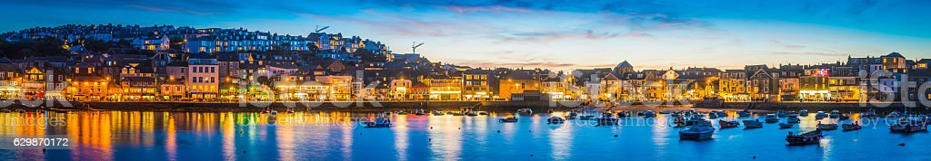 Waterfront restaurants homes warmly illuminated picturesque harbour St Ives Cornwall stock photo