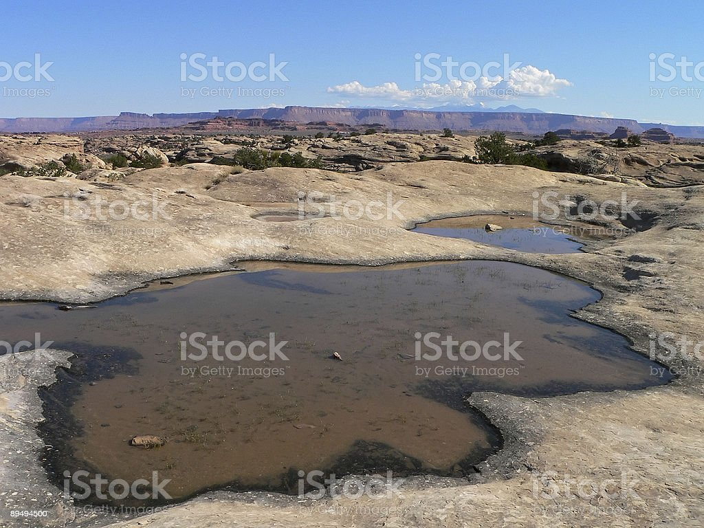waterholes on plateau with blue sky and clouds stock photo