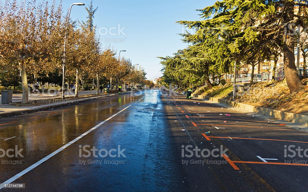 Watering and sweeping the streets of a City stock photo