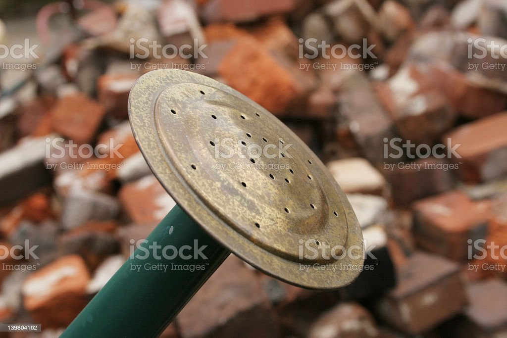 watering can and bricks royalty-free stock photo