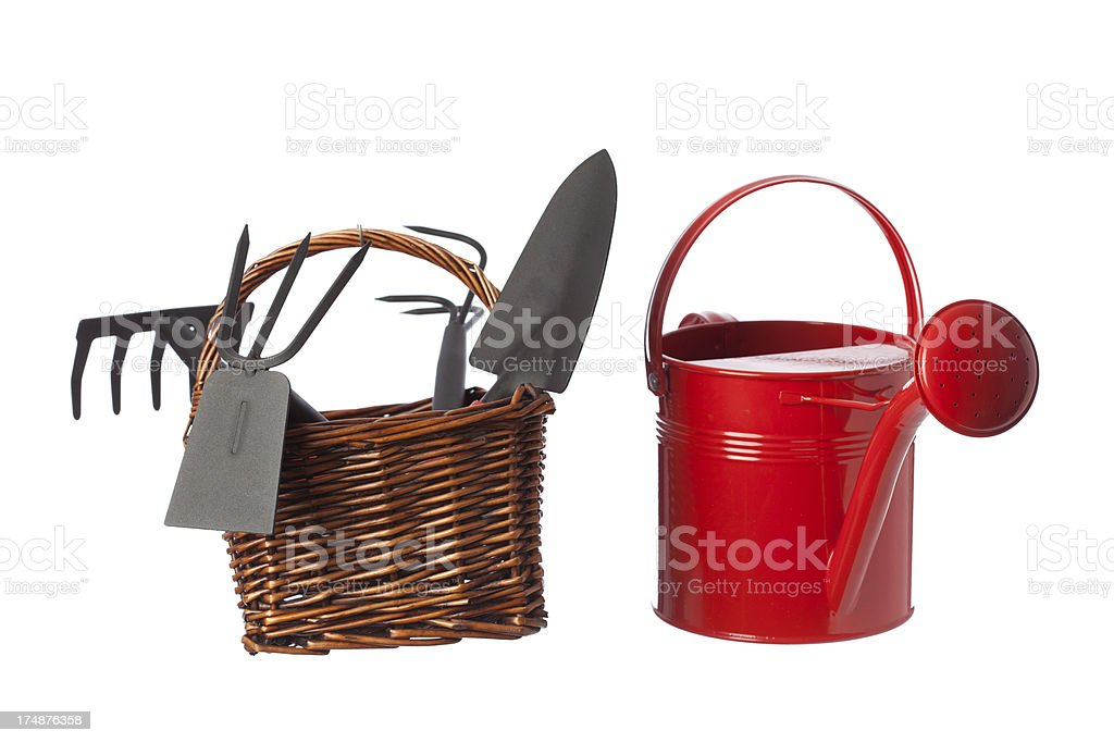Watering can and gardening equipments on white background royalty-free stock photo