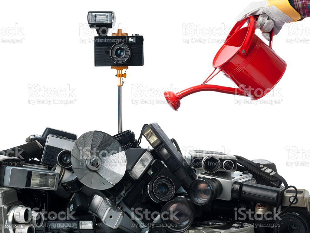 Watering Can On Cameras As One Of Them Is Up stock photo