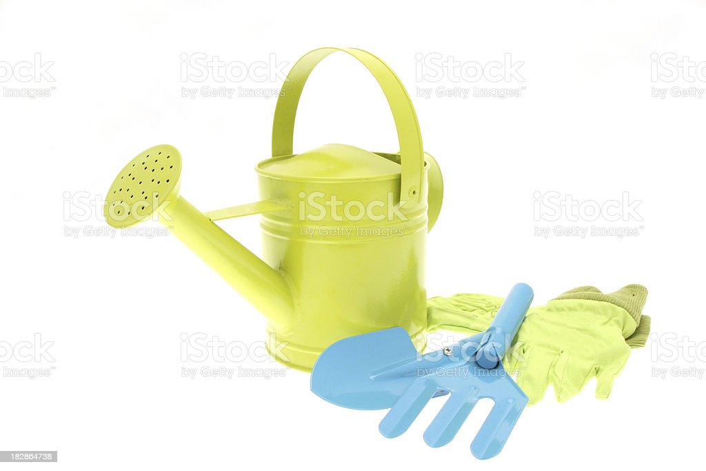 Watering can with gardening tools and gloves - High Key royalty-free stock photo