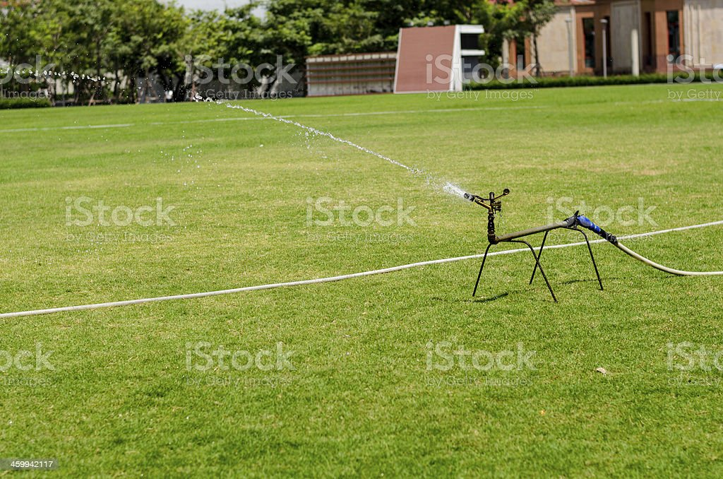 watering in football field stock photo