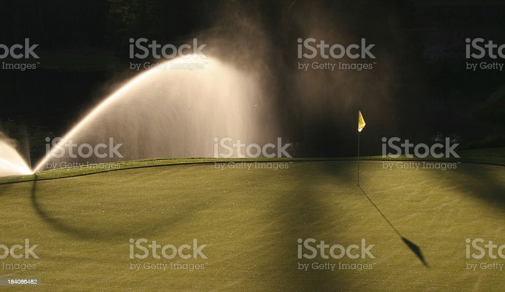 Watering the Golf Green stock photo