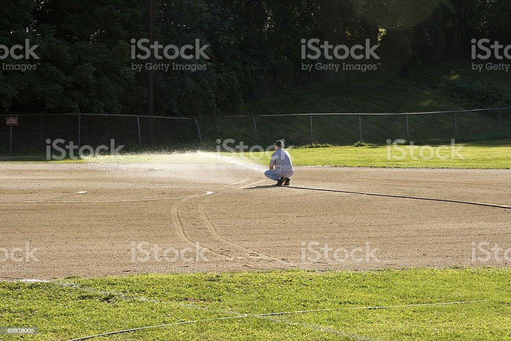 Watering The Infield stock photo